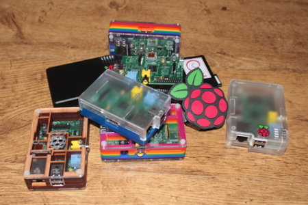 Collection of Raspberry Pis - cases from Pimoroni, ModMyPi and Cyntech
